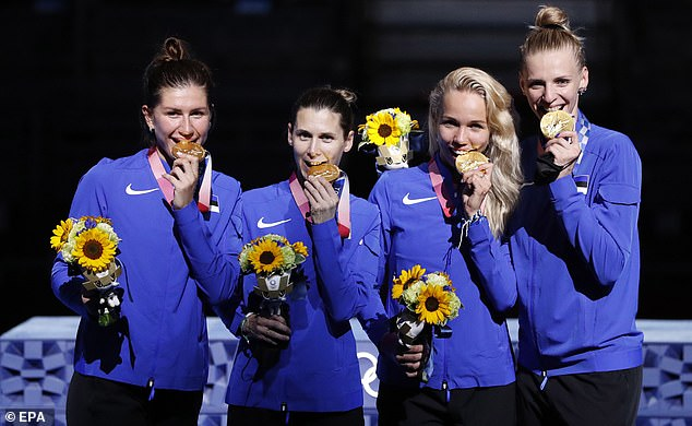 Team Estonia pose at the award ceremony of the women's Epee Team competition after Tokyo's fencing events. Froom left to right: Gold medallists Julia Beljajeva, Irina Embrich, Erika Kirpu and Katrina Lehis