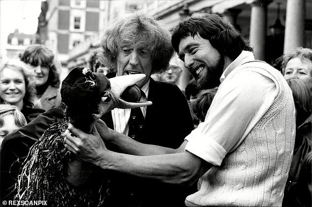 Hendrick takes revenge on Rod Hull's Emu, cricket ball in beak, in a picture taken in 1981