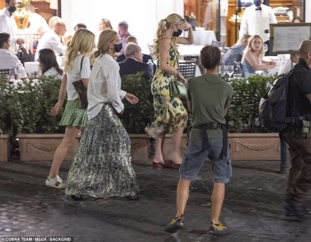 Summer dress:Kitty, who wowed in five Dolce & Gabbana alta moda gowns on Saturday and Sunday, wore yet another frock by the designers as she stepped out with her new husband and family (pictured)