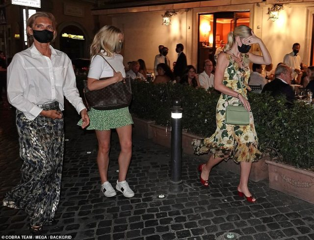 Family meal: Lady Kitty Spencer, who wed retail millionaire Michael Lewis, 62, at a 17th century castle on Saturday, joined her mother Victoria Aitken, 55, and 29-year-old sisters Lady Eliza and Lady Amelia Spencer for a meal out at the upmarket Dal Bolognese restaurant on Monday night. Pictured, leaving the restaurant with her mother and sister Amelia