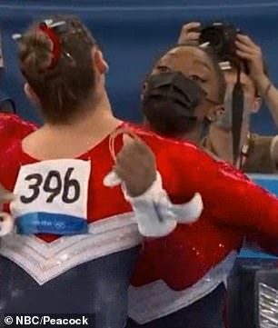 Support: The gymnast hugged each of her fellow Team USA athletes and reassured them that they were 'going to be fine', saying: 'You've been training your whole entire lives for this'