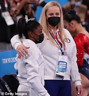 Heartbreak: Biles looked devastated as the news of her withdrawal was announced, and she was seen being comforted by one of her coaches, Cecile Landi