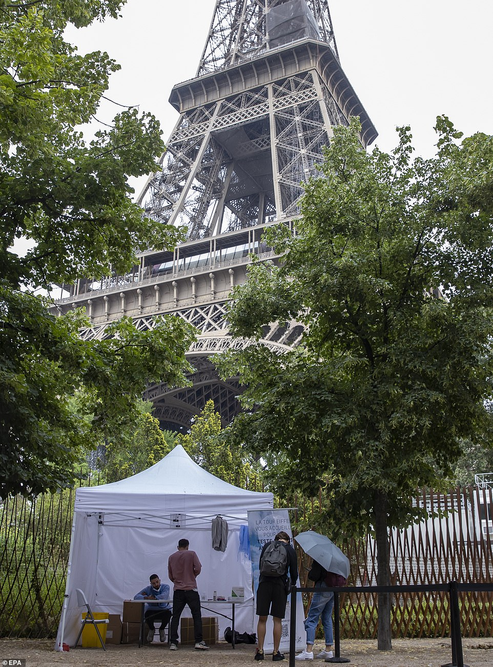 The shock move to place France in its own category earlier this month wrecked thousands of families' holidays. Pictured, a covid testing site by the Eiffel Tower in France
