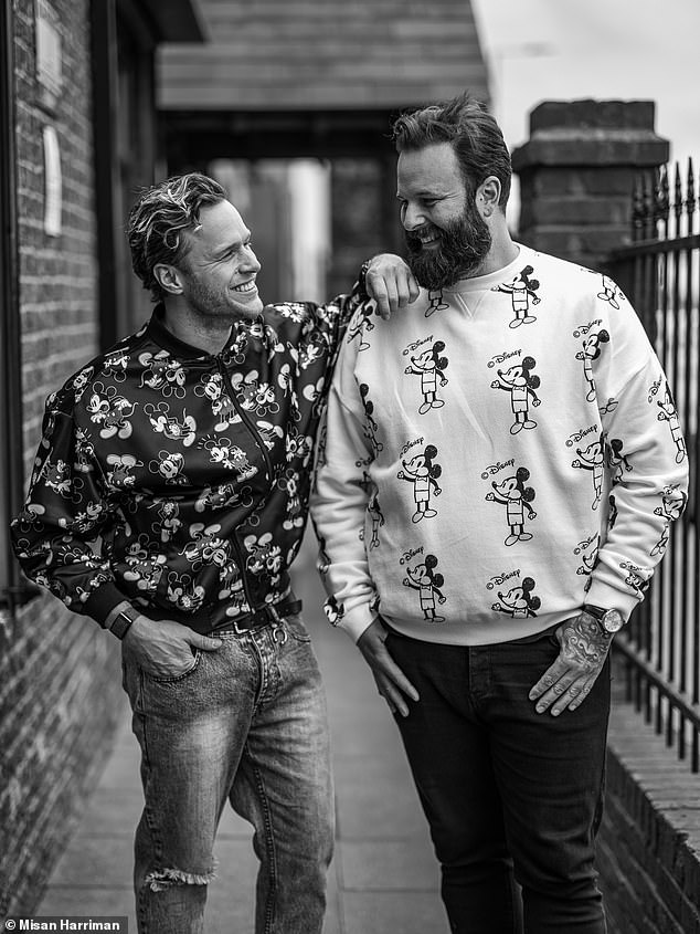 Pals: Olly Murs wore a Mickey Mouse hoodie as he posed alongside a friend