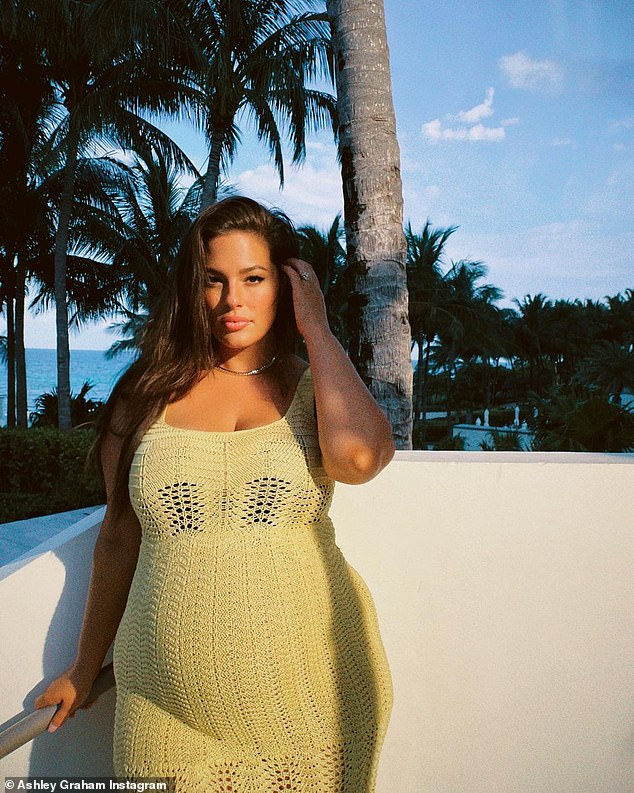 Fluffy yellow: Ashley Graham showed off her pregnancy glow by posing for new holiday photos posted to Instagram on Wednesday