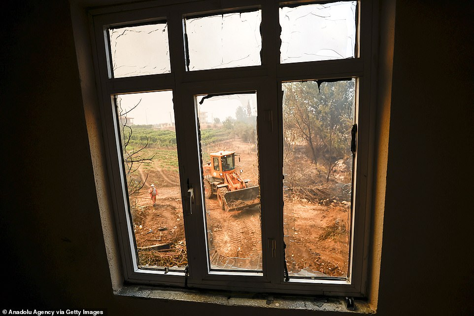 A view from a damaged house after a forest fire broke out in Manavgat district of Turkey's southern Antalya province on Wednesday