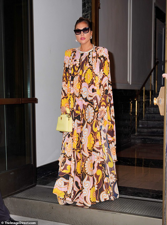 Mood: She added inches to her petite frame with a pair of her iconic heels and carried a pastel yellow Louis Vuitton handbag