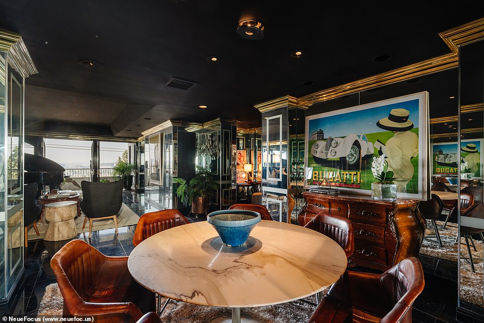 Chic: Inside, dark wood decor is accented by eclectic furnishings, giving