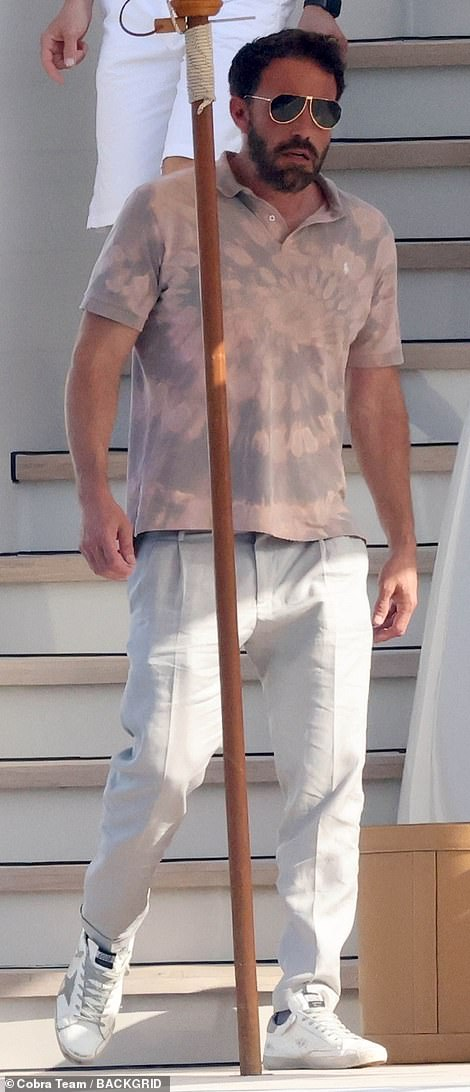 Stylish: Ben went casual with white pants and a tie-dye Ralph Lauren polo shirt