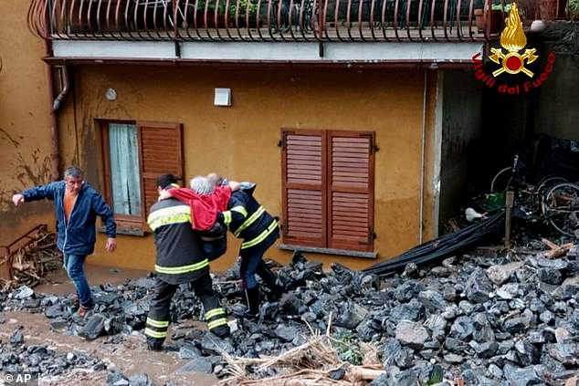 Heroic: The visit came after first responders evacuated more than 60 people as the area on Tuesday was hit by extreme weather conditions, leaving it covered in mud, logs and rubbish