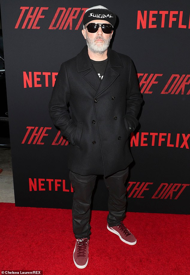 Recognizable: Many fans of the singer reacted in surprise in the comments section of the photo, with one comparing his facial hair to that of Hulk Hogan;  he is seen at the 2019 premiere of The Dirt