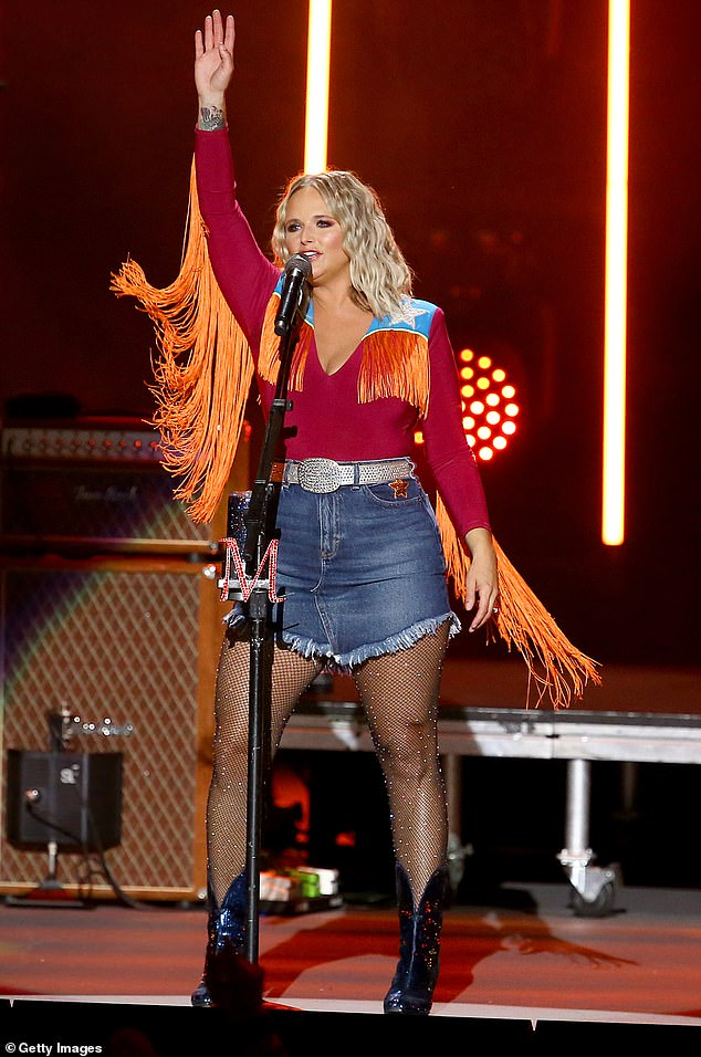 Rocking out: Miranda Lambert, 37, dons orange bangs and sparkly tights during her CMA Summer Jam performance in Nashville, Tennessee
