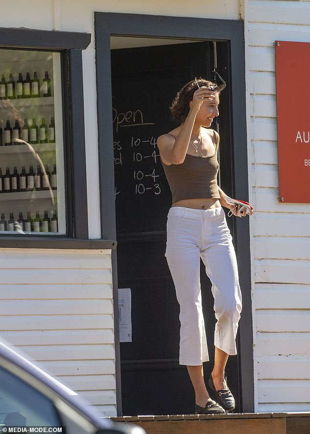 Casual chic: She paired the flattering garment with a pair of white three-quarter length pants and black leather loafers