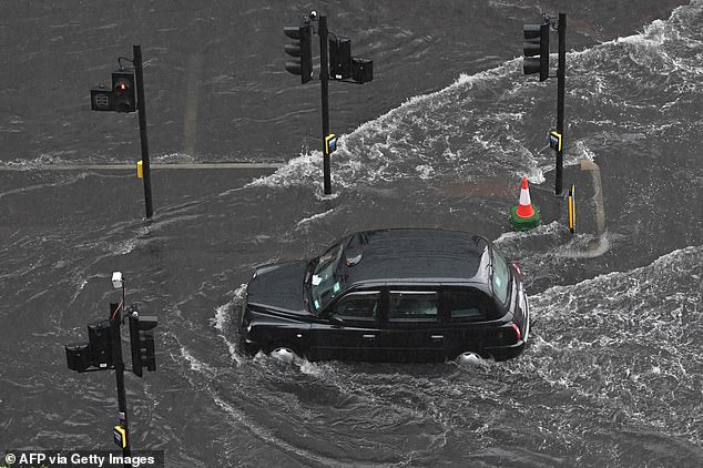 The study, published inthe journal Sustainability, follows severe flooding in the UK. Pictured, a London taxi in The Nine Elmson July 25
