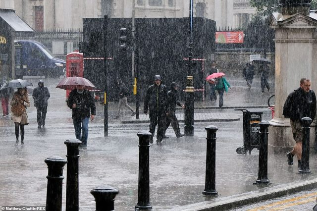 Storm Evert is set to bring 'unseasonably strong winds and heavy rain to southern parts of the UK into Friday', the Met Office said (pictured: rain showers in central London on Wednesday)