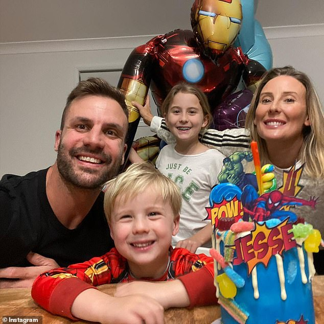 One happy family: In the second image, Beau, his wife Jesse and the couple's daughter Remi, eight, are all grinning alongside the birthday boy