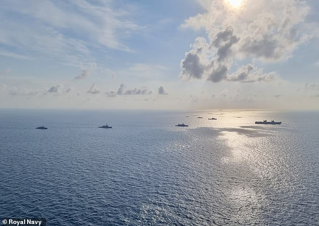 Big Lizzie (far right) has been sailing across the globe accompanied by ships that form the UK strike carrier group, in one of the largest concentrations of British naval power in a generation