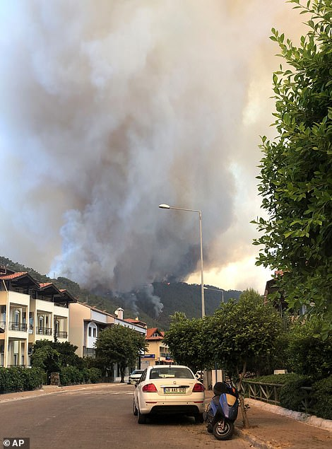 Efforts to extinguish rapidly spreading wild fires continued on Thursday as fires raged on