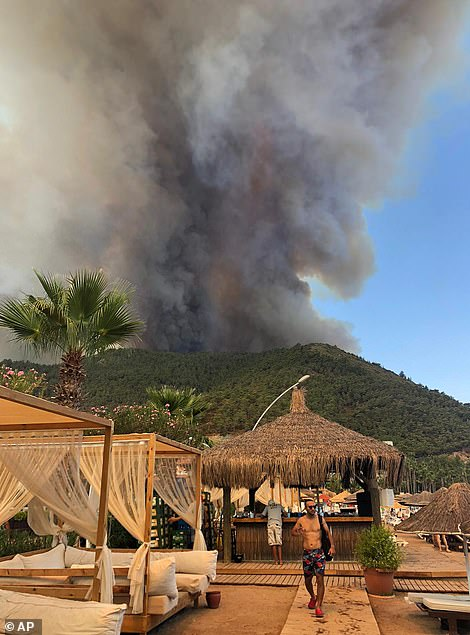 Smokes rises over a hotel in Icmeler, southern Turkey