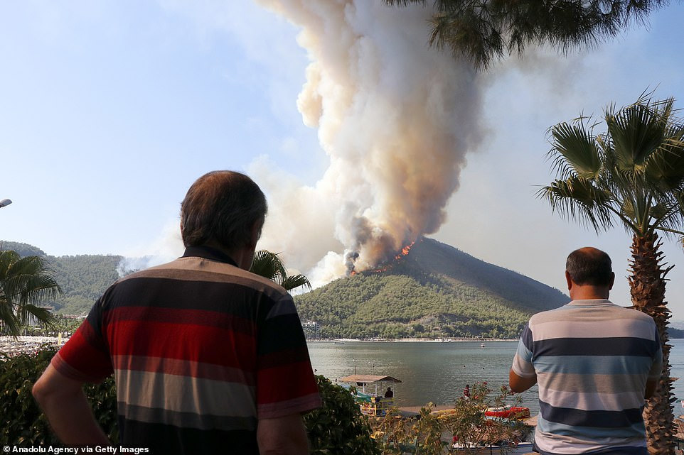 Smoke rises as firefighters continued works on extinguishing the forest fire that broke out in Mugla's Marmaris district on Thursday