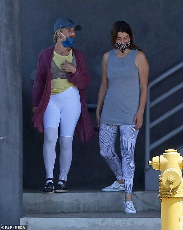 Cohen was accompanied by a female friend as she walked to the store. Both were dressed in workout clothes