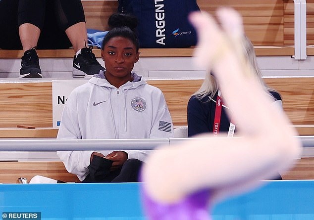 Simone Biles watches from the stands at the Tokyo Olympics gymnastics, artistic Women's All-Around Final