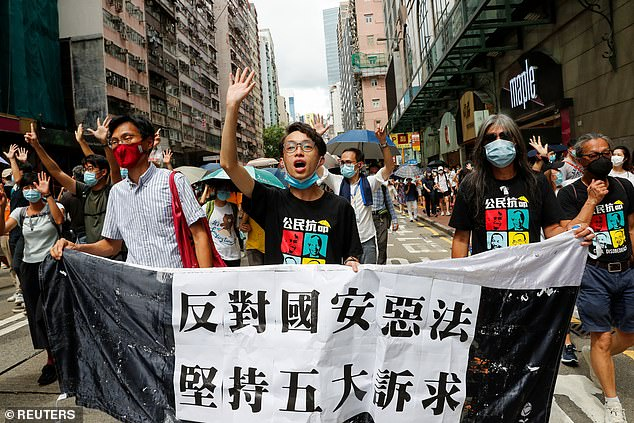 Tong Ying-kit's apparent stunt on July 1 (pictured, protests the same day) came a day after Beijing imposed sweeping national security legislation on Hong Kong