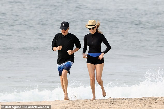Couples that work out: The pair were seen hitting the beach for an early morning run on Friday