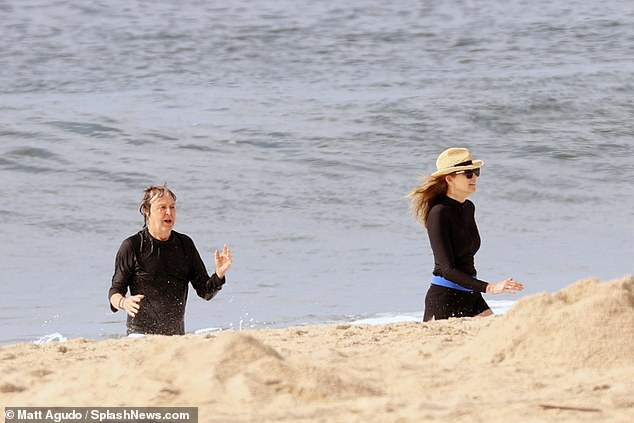 Cooling off: The couple made sure to take a dip after working up a sweat on the sand