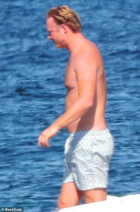 Topping up the tan:William kept things low-key, going shirtless in swim shorts while aboard the boat