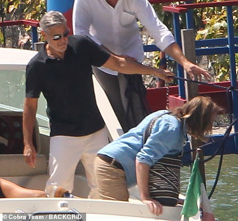 Leading the way: He seemed to be the first Clooney off the boat