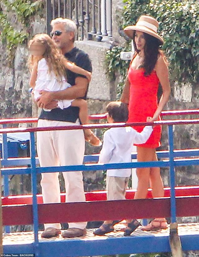 All together: George and Amal could not stop smiling as they spent quality time with their two adorable children on Thursday