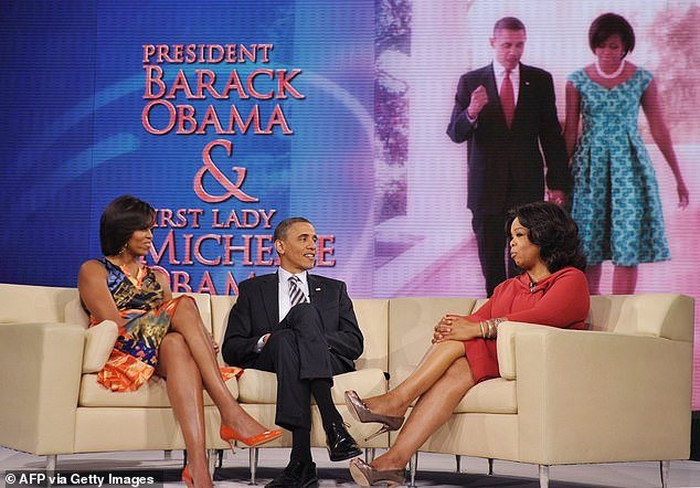 US President Barack Obama and First Lady Michelle Obama chat with talk show host Oprah Winfrey