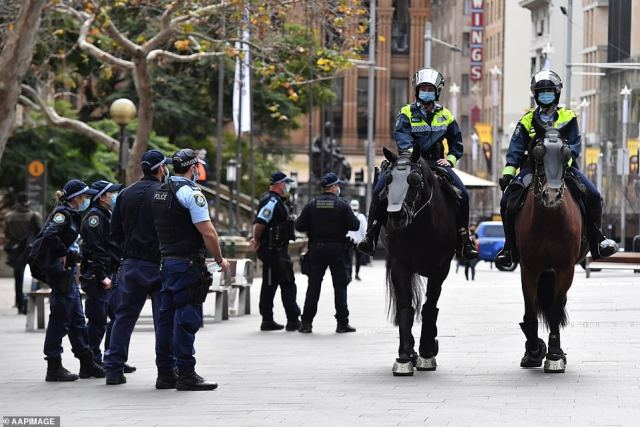 Officers patrol George Street in Sydney on Saturday in anticipation of another anti-lockdown rally (pictured)