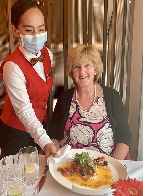 Pictured is Lesley enjoying dinner in Amalfi on Spirit of Adventure