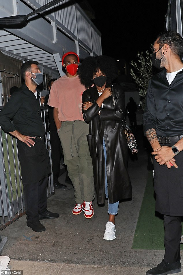 Stars:Also on the night out was Russell who dressed in a red T-shirt and khaki trousers as he walked into the restaurant alongside his wife Nina who wore a black leather coat