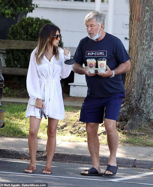 Coffee Race: The Dr Death star, 63, and the 37-year-old fitness entrepreneur were seen strolling the sidewalk after stopping at Jack's Stir Brew Coffee in Amagansett, New York