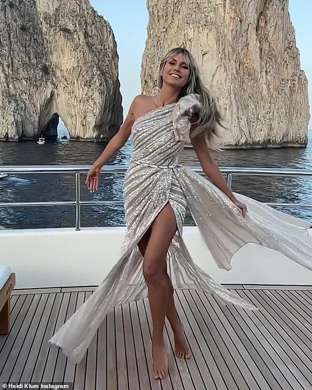 Radiant: Heidi Klum, 48, sparkled in an Elie Saab dress aboard a luxury yacht ahead of a UNICEF gala in Capri on Saturday night