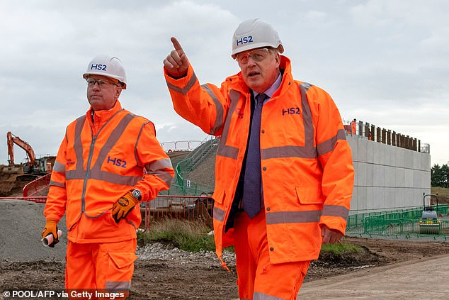 The Prime Minister was warned voters in 'Red Wall' constituencies would be furious at the idea of the Leeds leg being shelved (Pictured: PM Boris Johnson on site of a part of HS2)