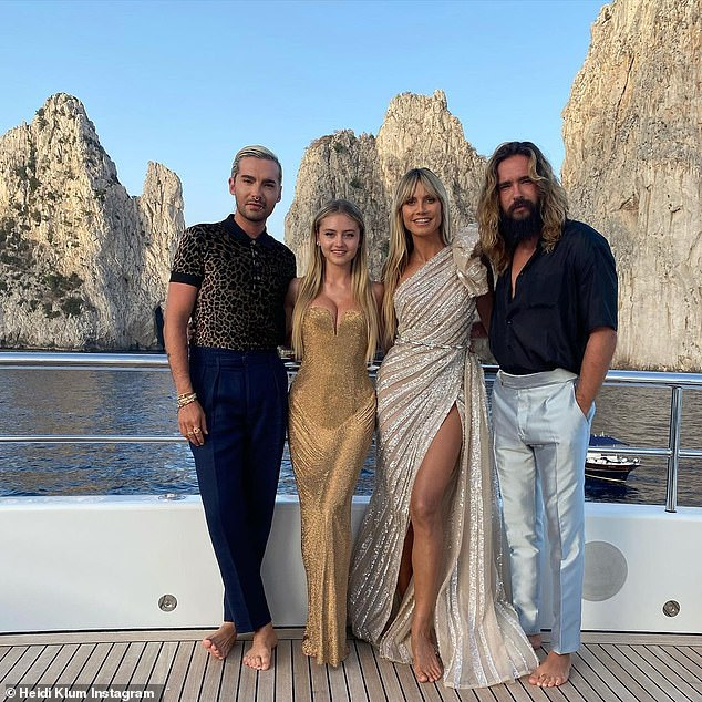 Dressed New: Heidi, Tom, her twin Bill and daughter Leni all showed off formal looks as they posed against the stunning Italian backdrop