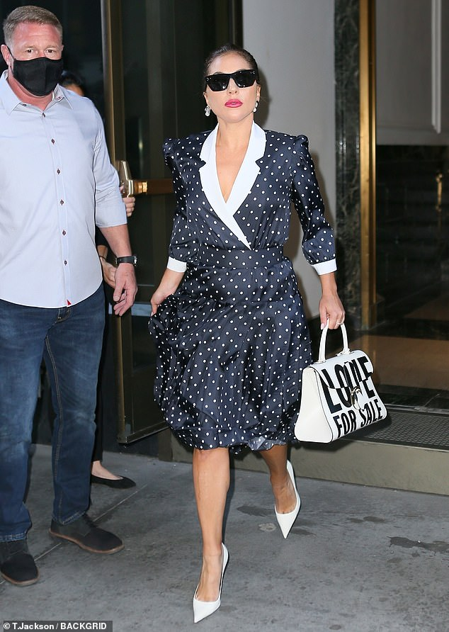 Old-school glamour: Lady Gaga, 35, channeled '50s style in a black satin polka dot dress as she left her New York City hotel on Saturday to head to rehearsals at Radio City Music Hall