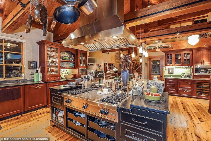 Modern-meets-rustic: The mansion offers plenty of luxury amenities including this dreamy kitchen space