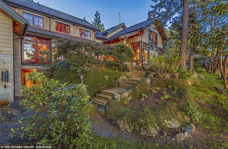 Rural: The house sits on a layered hillside, nestled amid the natural beauty of Orcas Island