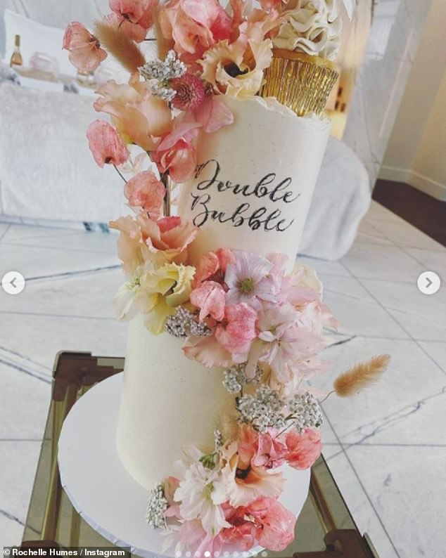 Rochelle also showed off the food at the event, including a very expensive looking two-tiered cake with floral decoration.