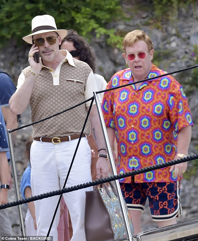 Designer gear: Elton upped his height with a pair of navy and white sneakers, also from Gucci