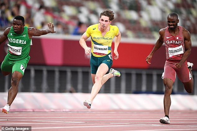 Enoch Adegoke of Team Nigeria (left), Rohan Browning of Team Australia (centre) and Femi Ogunode of Team Qatar (right) compete in the Men's 100m Semi-Final on day nine of the Tokyo 2020 Olympic Games at Olympic Stadium on August 1, 2021 in Tokyo, Japan