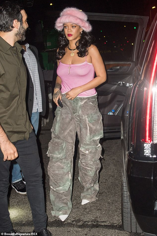 Braless: Rihanna put on a steamy show as she stepped out in New York City in a stylish outfit on Saturday