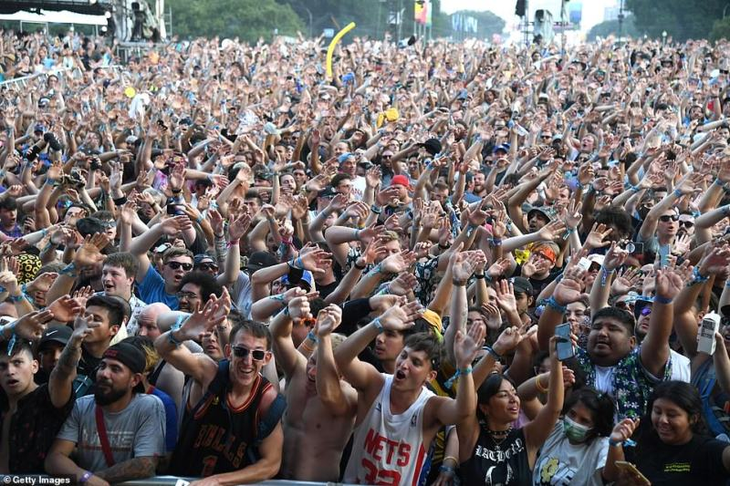 The Lollapalooza festival in Chicago, pictured on Saturday, has drawn crowds of 100,000 people every day. Attendees are asked to show proof of vaccination or a negative COVID test at the entrance, but health officials still fear a surge in cases in the coming weeks as a result of the gathering