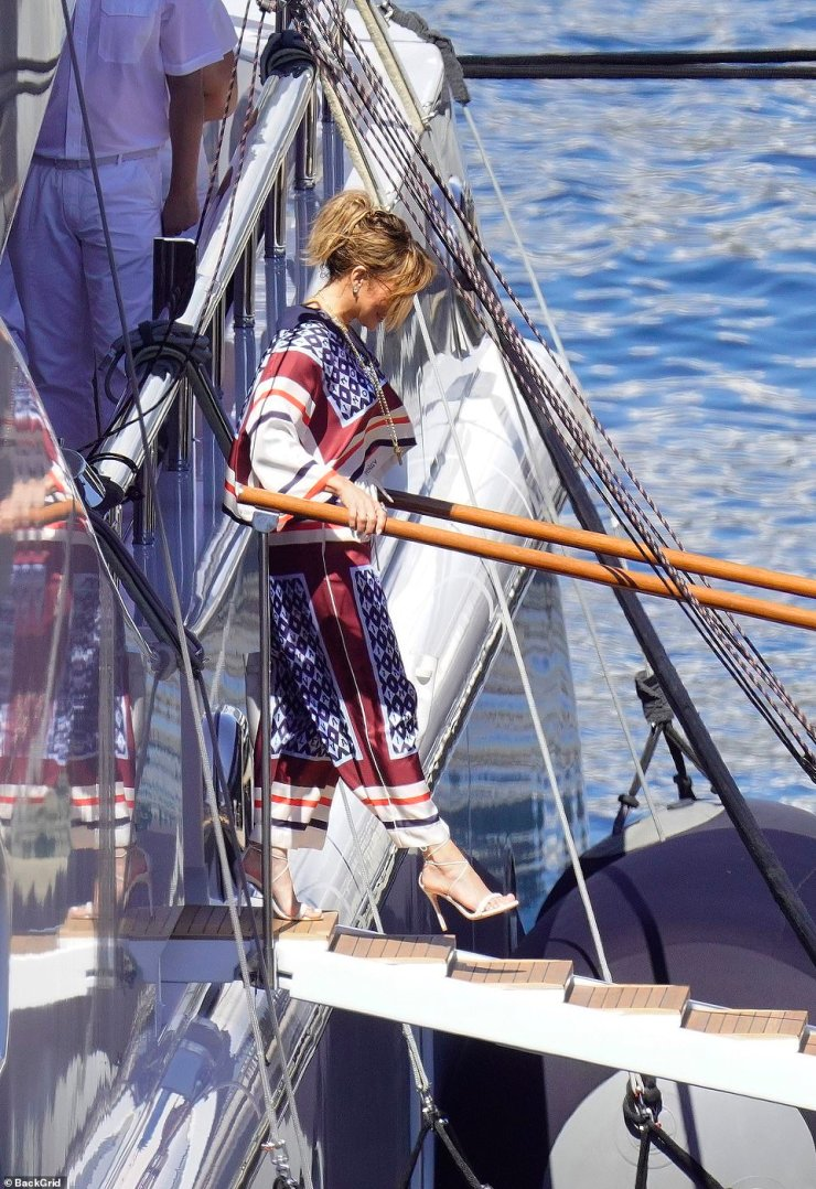 Easy does it: JLo carefully eased herself onto the jetty before strutting her stuff on the way back to land where a car was waiting for her