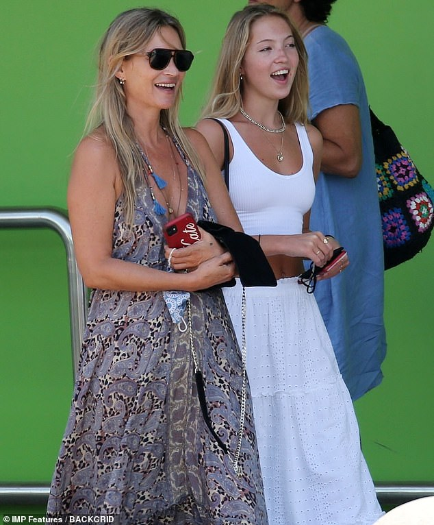 Summer look:The supermodel was spotted picking up her mini-me from Aeroport d'Eivissa on Sunday wearing a paisley print summer dress while her daughter looked stunning in a white crop top and maxi skirt combination